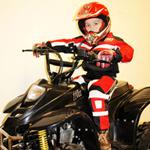 kid on a 4-wheeler
